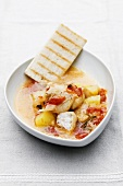 Spicy fish stew with white bread