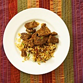 Hot and sour lamb with rice (India)