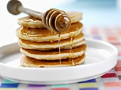 Pancakes with honey and honey dipper