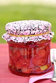 A jar of strawberry jam to give as a gift