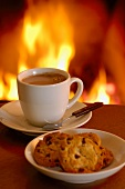 Hot chocolate and biscuits by the fireside