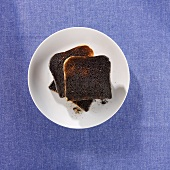 Three slices of burnt toast