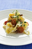 Ribbon pasta with pork fillet, goat's cheese and thyme