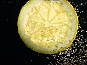 A slice of lemon in a glass of water