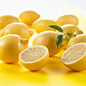 Whole lemons and one halved lemon