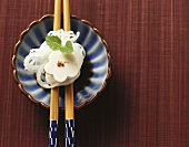 Tofu flower on radish strands