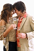 Young lovers holding glasses of sparkling wine