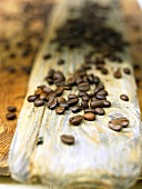 Coffee beans on a plank of wood