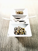 Capers and spoons in an hors d'oeuvres dish