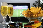 Pils and crisps in front of television