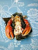 Steamed lobster in a banana leaf