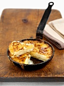 Potato gratin in a small frying pan