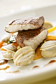 Fried sea bream fillet with shellfish