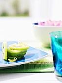 Slices of kiwi fruit on blue plate