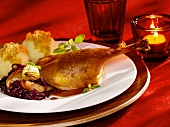 Leg of goose with apple red cabbage and potato dumplings
