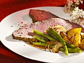 Roast beef with beans and roast potatoes