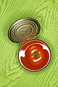 Fresh tomato in an opened tin
