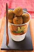 Falafel (chick-pea balls) in plastic cup