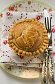 Meat pie on fabric napkin