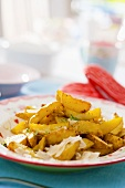 Potato wedges with herbs and Parmesan
