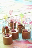 Chocolate mousse with raspberries in small glasses