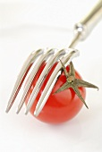Tomato and fork (close-up)