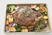 Beef steak with roasted vegetables on baking tray