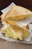 Toasted cheese sandwiches, in a pile