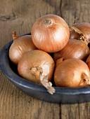 Brown onions in a ceramic dish