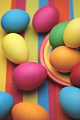Coloured Easter eggs on striped cloth
