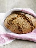 Organic bread in a tea towel