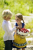 Boy and girl with strawberry cake