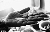 Salt in someone's hand (black and white photo)