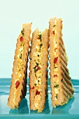 Three toasted cottage cheese and mango chutney sandwiches