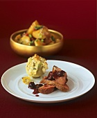 Duck with cherry sauce and artichoke with gratin topping