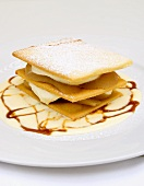 Layered dessert with poached pears and caramel
