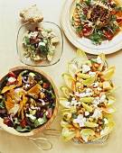Assorted salads with beans, apples, chicken and feta