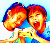 Two children eating one sandwich