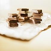 Three piles of chocolate pieces