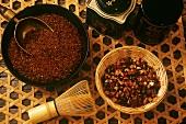Still life with tea whisk, teas and tea caddies