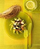 Salad of orange segments, avocado, olives and tomatoes