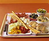 Tray of appetisers: pickled vegetables, bread, sausage, cheese