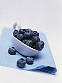 Blueberries on a porcelain spoon
