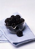 A small dish of blackberries (can also represent wine bouquet)