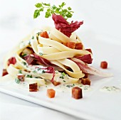 Ribbon pasta with radicchio and bacon sauce