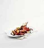 Rack of lamb with red wine onions and rosemary potatoes