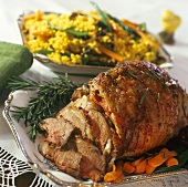 Roast lamb with a side dish of bulgur and vegetables