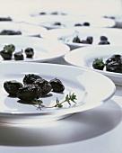 Black olives on white plates
