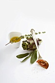 Still life with artichoke, herbs and olive oil