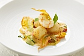 Semolina dumplings with seafood & Mediterranean vegetables